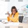 businesswoman-analysing-document-P8WSNMC-2